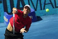 Czech Tomas Berdych returns a ball to Argentinian Juan Martin Del Potro during their semi-final tennis match of the Madrid Masters. Berdych won 7-6 (7/5), 7-6 (8/6)