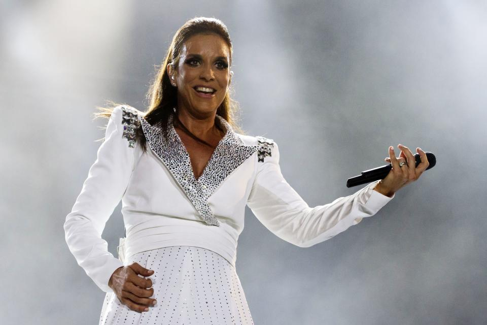 FILE - This Sept. 30, 2011 file photo shows singer Ivete Sangalo performing during the Rock in Rio music festival in Rio de Janeiro, Brazil. Sangalo will celebrate her 20-year career with a five city U.S. tour that takes her to the West Coast for the first time. (AP Photo/Felipe Dana, File)
