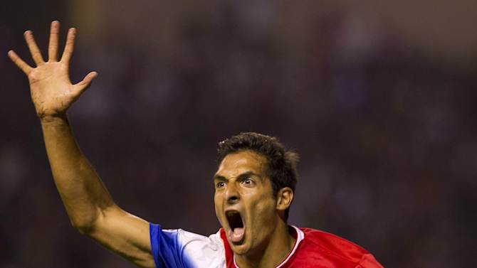 Costa Rica's Celso Borges celebrates his goal against the U.S. at a 2014 World Cup qualifier soccer match in San Jose, Costa Rica, Friday, Sept. 6, 2013. (AP Photo/Moises Castillo)