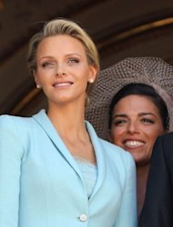 Princess Charlene of Monaco (L) poses on the balcony next to her Maid of Honour Donatella Knecht de Massy after her civil wedding to Prince Albert II of Monaco at the Prince's Palace in Monaco