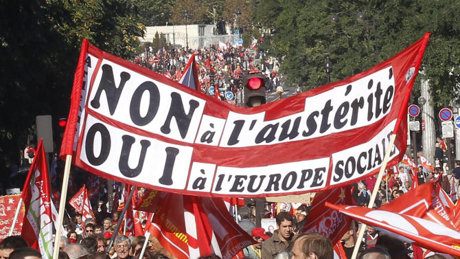 "Demonstrators march during a rally holding a banner which reads,""no to the austerity, yes to the the social Europe"", to protest against the austerity measures announced by the French government, in Paris, Sunday, Sept 30, 2012. (AP Photo/Michel Euler)"