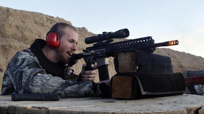 FILE - In this Dec. 23, 2012 file photo, Michael Reed, of Cedar Park, Texas, shoots an AR-15 rifle, at Dragonman's firing range and gun dealer, outside Colorado Springs, Colo.  From Oregon to Mississippi, President Barack Obama's proposed ban on new assault weapons and large-capacity magazines struck a nerve among rural lawmen and lawmakers, many of whom vowed to ignore any restrictions and even try to stop federal officials from enforcing gun policy in their jurisdictions. (AP Photo/Brennan Linsley, File)