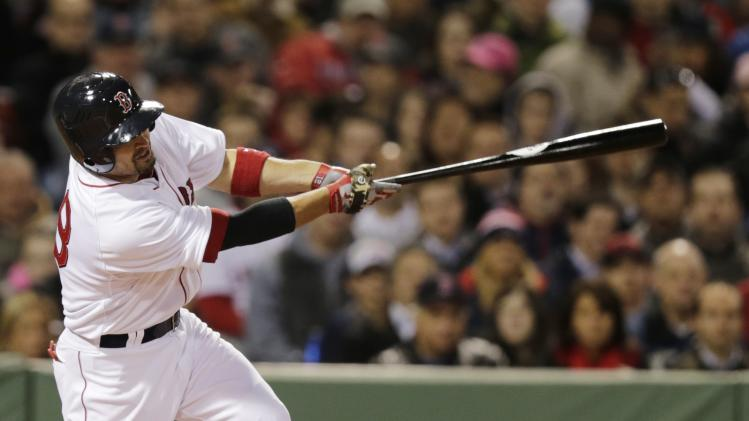Boston Red Sox right fielder Shane Victorino singles during the third inning of a baseball game against the New York Yankees, Thursday, April 24, 2014, in Boston. (AP Photo/Charles Krupa)