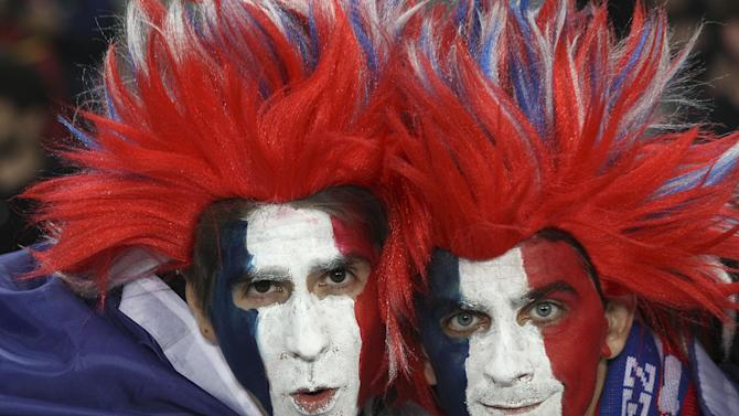 French fans pose for the camera ahead of their team's Rugby World Cup final against the New Zealand All Blacks at Eden Park in Auckland, New Zealand, Sunday, Oct. 23, 2011.(AP Photo/Rob Griffith)