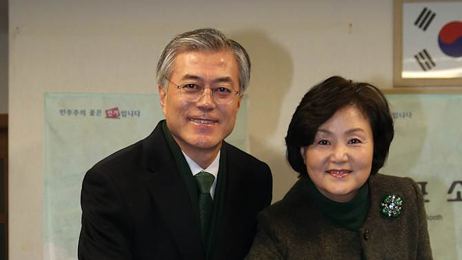 South Korean opposition Democratic United Party's presidential candidate Moon Jae-in and his wife Kim Jung-sook cast their votes for the presidential election at a local polling station in Busan, south of Seoul, South Korea, Wednesday, Dec. 19, 2012. South Koreans bundled in thick mufflers and parkas braved frigid weather Wednesday to choose between the liberal son of North Korean refugees and the conservative daughter of a late dictator. For all their differences, the presidential candidates hold similar views on the need to engage with Pyongyang and other issues. (AP Photo/Yonhap, Kim Hyun-tai) KOREA OUT