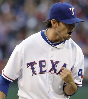 Texas Rangers' pitcher Clay Rapada reacts after closing out the sixth inning against the New York Yankees during Game 2 of baseball's American League Championship Series Saturday, Oct. 16, 2010, in Arlington, Texas. (AP Photo/Tony Gutierrez)