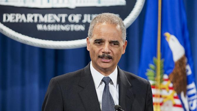 Attorney General Eric Holder speaks about a Justice Department settlement with Johnson & Johnson during a news conference at the Department of Justice in Washington, Monday, Nov. 4, 2013. Johnson & Johnson and its subsidiaries have agreed to pay over $2.2 billion to resolve criminal and civil allegations of promoting three prescription drugs for off-label uses not approved by the Food and Drug Administration.. (AP Photo/Manuel Balce Ceneta)