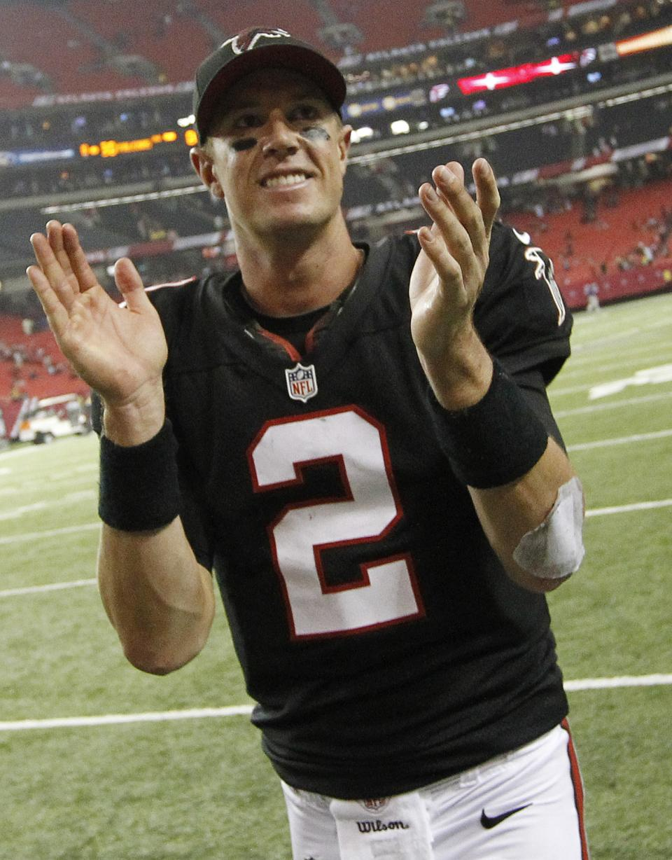 Atlanta Falcons quarterback Matt Ryan (2) reacts following a win over the Carolina Panthers during the second half of an NFL football game Sunday, Sept. 30, 2012, in Atlanta. The Falcons beat the Panthers 30-28. (AP Photo/John Bazemore)