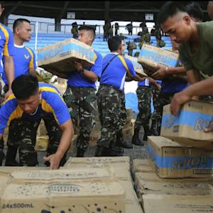 Corporations aide in Typhoon Haiyan relief effort