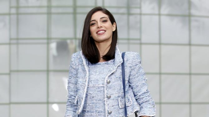 Lebanese actress Razane Jammal poses during a photocall before German designer Karl Lagerfeld Haute Couture Spring Summer 2015 fashion show for French fashion house Chanel in Paris
