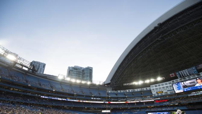 Toronto Blue Jays starting pitcher Mark Buehrle throws against the New York Yankees as the roof of Rogers Centre is open for the first time this season during fifth inning American League baseball action in Toronto, Wednesday, May 6, 2015. (Frank Gunn/The Canadian Press via AP) MANDATORY CREDIT