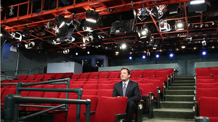 "This Monday, Oct. 29, 2012 photo released by NBC shows host Jimmy Fallon sitting in an empty studio where his show ""Late Night with Jimmy Fallon,"" is taped in New York. The audience was absent due to inclement weather caused by superstorm Sandy. (AP Photo/NBC, Lloyd Bishop)"