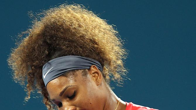 Serena Williams of the United States reacts to a line call in her match against Alize Cornet of France at the Brisbane International tennis tournament in Brisbane, Australia, Tuesday, Jan. 1, 2013.  (AP Photo/Tertius Pickard).
