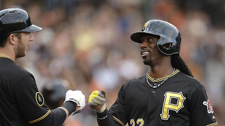 Pittsburgh Pirates' Andrew McCutchen, right, is congratulated by Brent Morel after McCutchen scored against the San Francisco Giants in the first inning of a baseball game Monday, July 28, 2014, in San Francisco. (AP Photo/Ben Margot)