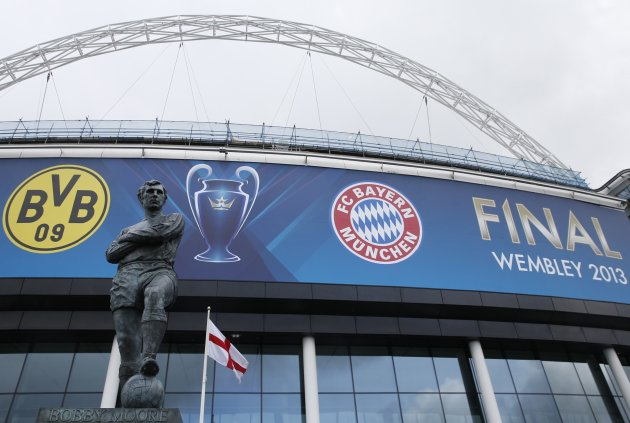 A statue of former England player Bobby Moore stands outside Wembley Stadium before the training sessions of Bayern Munich and Borussia Dortmund ahead of their Champions League Final soccer match in L