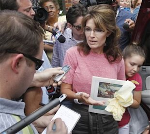 This is a vacation? Sarah Palin talks to reporters about Paul Revere during a June 2, 2011,