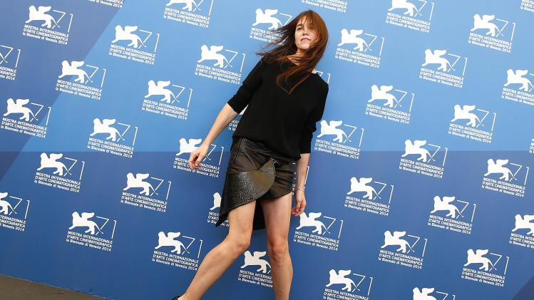 "Actress Gainsbourg poses during the photo call for the movie ""3 Coeurs"" at the 71st Venice Film Festival"