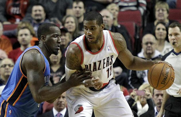Portland Trail Blazers forward LaMarcus Aldridge, right, backs in on Oklahoma City Thunder center Kendrick Perkins during the first half of an NBA basketball game in Portland, Ore., Wednesday, Dec. 4,