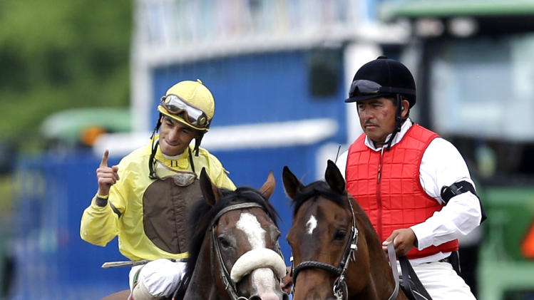 Jockey John Velazquez, left, celebrates after Union Rags won the Belmont Stakes horse race in Elmont, N.Y., Saturday, June 9, 2012. (AP Photo/David J. Phillip)