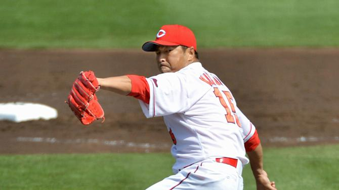 Hiroshima Carp pitcher Hiroki Kuroda throws during a game against the Yakult Swallows in Hiroshima, western Japan Sunday, March 29, 2015. Former New York Yankees pitcher Kuroda won his first game in his return to Japanese baseball on Sunday. (AP Photo/Kyodo News) JAPAN OUT, MANDATORY CREDIT