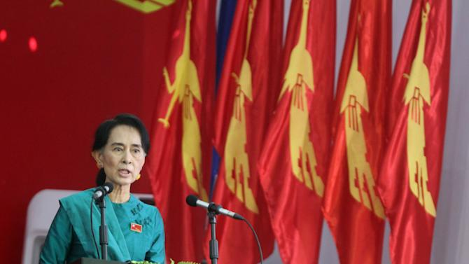 Myanmar opposition leader Aung San Suu Kyi speaks during the first day session of the first ever congress of her National League for Democracy (NLD) at Royal Rose restaurant in Yangon, Myanmar, Saturday, March. 9, 2013. The NLD is holding an all-party congress to elect its own leadership for the first time in the group's 25-year history— an important step toward making it more reflective of its democratic ideals. It is a sign of how far Myanmar has come with political reform that the gathering is allowed at all. But it's also a test for the NLD, which is working to transform itself from a party of one into a structurally viable political opposition in time for national elections in 2015. (AP Photo/Khin Maung Win)
