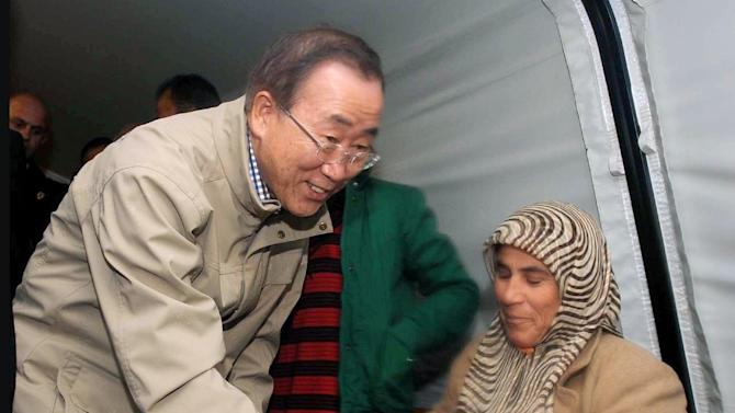 U.N. chief Ban Ki-moon visits Syrian refugees at a camp in Islahiye, near the Syrian border, Turkey, Friday, Dec. 7, 2012. Ban will also meet Turkish officials in Ankara Friday for talks on the Syrian civil war.(AP Photo/Veli Gurgah, Pool)
