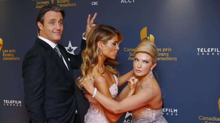 TV personalities Brian Mulroney, Dina Pugliese and Cheryl Hickey arrive on the red carpet at the 2014 Canadian Screen awards in Toronto