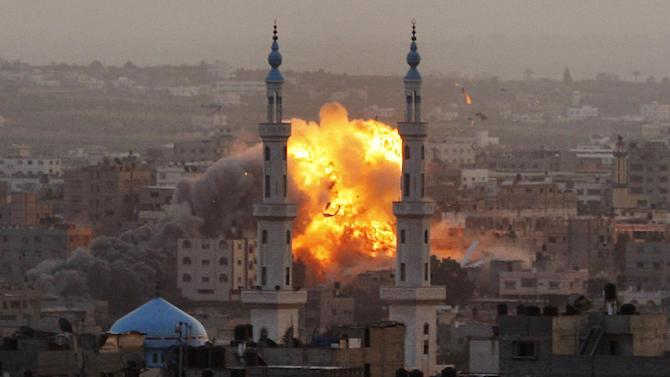 FILE - In this Nov. 17, 2012 file photo, smoke rises during an explosion from an Israeli strike in Gaza City. Israel bombarded the Hamas-ruled Gaza Strip with nearly 200 airstrikes widening a blistering assault on Gaza rocket operations by militants to include the prime minister's headquarters, a police compound and a vast network of smuggling tunnels. 2012 was a year of storms, of raging winds and rising waters, but also broader turbulence that strained our moorings. Old enmities and grievances resurfaced in the Middle East, clouding the legacy of the 2011 Arab spring. And Israeli and Palestinian civilians suffered through another escalation of the conflict in Gaza. (AP Photo/Hatem Moussa, File)