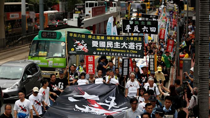 Protesters take to the streets before the anniversary of the military crackdown on the pro-democracy movement at Beijing's Tiananmen, in Hong Kong