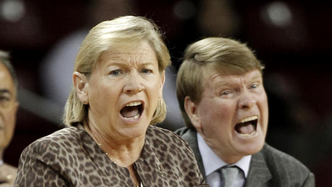 North Carolina coach Sylvia Hatchell, left, and associate head coach Andrew Calder shout at an official during the first half of an NCAA college basketball game against Boston College in Boston on Thursday, Feb. 7, 2013. (AP Photo/Winslow Townson)