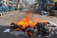 Bangladeshi Islamist activists set fire to material to block a street during clashes with police in Dhaka on February 22, 2013. Bangladesh police fired tear gas and rubber bullets Friday in fierce clashes with Islamists demanding the execution of bloggers they accused of blasphemy, killing at least four and injuring around 200