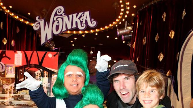 From third left, Andy MacDonald and Haden MacDonald are seen with Wonka's Oompa Loompas at the new Wonka store at Sweet! Hollywood during the launch of the Wonka Inventing Room Collection, a decadent premium chocolate line, on Tuesday Nov. 13, 2012, in Los Angeles. (Photo by Casey Rodgers/Invision for WONKA/AP Images)