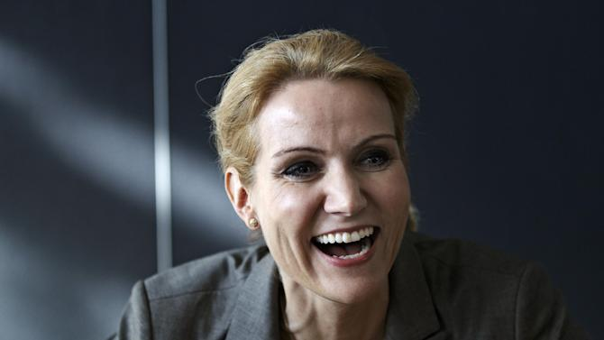 Leader of the Danish Social Democrats Helle Thorning-Schmidt  smiles at Christiansborg Palace in Copenhagen on Sunday, Oct. 2, 2011. The negotiations of the new Danish Government has ended, and it will be presented to Danish Queen Margrethe and the public Monday. Helle Thorning-Schmidt will be the first female Prime Minister in Denmark. (AP Photo/POLFOTO, Jens Dresling)  DENMARK OUT