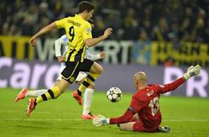 Borussia Dortmund 3-2 Malaga (Agg 3-2): Two goals in injury time seal victory in breathless encounter