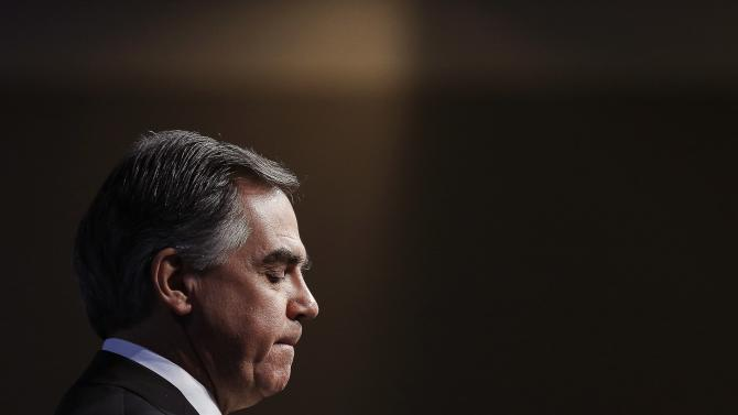 Alberta Premier Prentice pauses while speaking at a political event in Ottawa