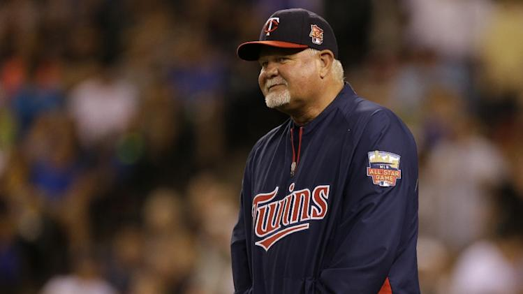 Minnesota Twins manager Ron Gardenhire walks on the field during a baseball game against the Seattle Mariners, Thursday, July 10, 2014, in Seattle. (AP Photo/Ted S. Warren)