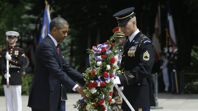 President Barack Obama participates in the wreath-laying ceremony at the Tomb of the Unknowns at Arlington National Cemetery on Memorial Day, May 27, 2013, in Arlington, Va. (AP Photo/Pablo Martinez Monsivais)