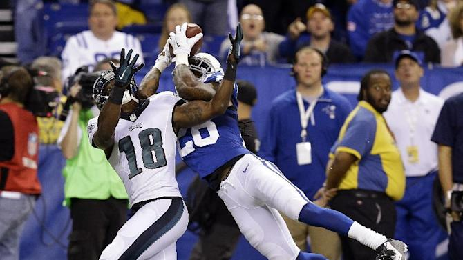 Indianapolis Colts Greg Toler makes an interception against Philadelphia Eagles wide receiver Jeremy Maclin (18) during the first half of an NFL football game Monday, Sept. 15, 2014, in Indianapolis