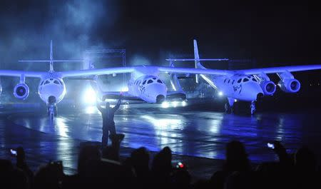 File photo of Virgin Galactic's SpaceShipTwo, which is carried by a twin-hulled aircraft named Eve, being unveiled in Mojave
