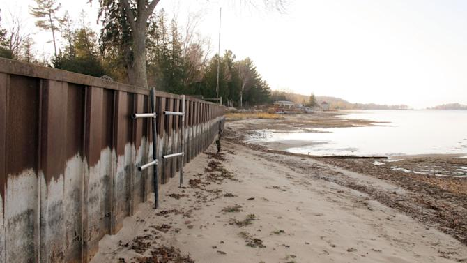 In this Nov. 16, 2012 photo, the white streaks on a steel breakwall show the normal water level on Portage Lake at Onekama, Mich., which is connected by a channel to Lake Michigan. Levels across much of the Great Lakes are abnormally low, causing problems for small harbor towns that rely on boating and water tourism. The Great Lakes, the world's biggest freshwater system, are dropping because of drought and climbing temperatures, a trend that accelerated with this year's almost snowless winter and scorching summer. (AP Photo/John Flesher)