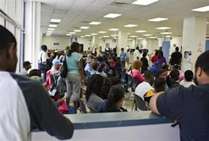 People fill the waiting area of a Pennsylvania Department of Transportation office in Philadelphia as they wait to get a voter ID card.