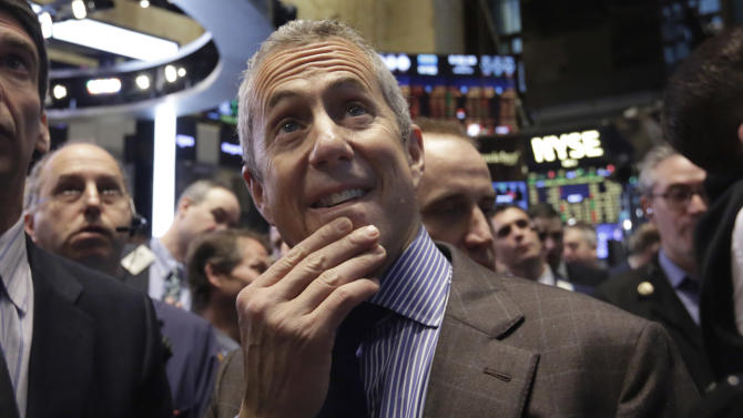Danny Meyer, center, Founder & CEO of Union Square Hospitality Group, waits for the Shake Shack IPO to begin trading, on the floor of the New York Stock Exchange, Friday, Jan. 30, 2015. Shares of Shake Shack Inc. have more than doubled minutes after they debuted on the stock market Friday.(AP Photo/Richard Drew)