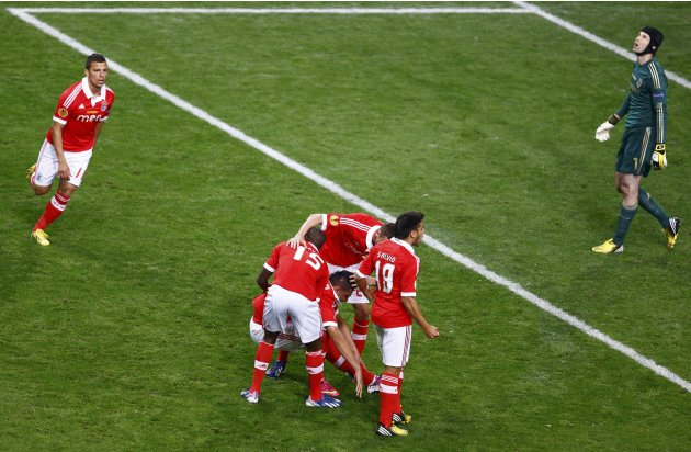 Benfica's Cardozo collapses with cramp after scoring a penalty past Chelsea's goalkeeper Cech during their Europa League final soccer match at the Amsterdam Arena