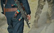 A member of the Afghan police is seen walking behind a US Army soldier during a joint patrol near Kandahar Air Field, on September 12. NATO-led forces are scaling back joint operations with Afghan forces after a spate of &quot;insider attacks&quot; in which Afghan recruits turned their weapons on Western allies, officers said Tuesday