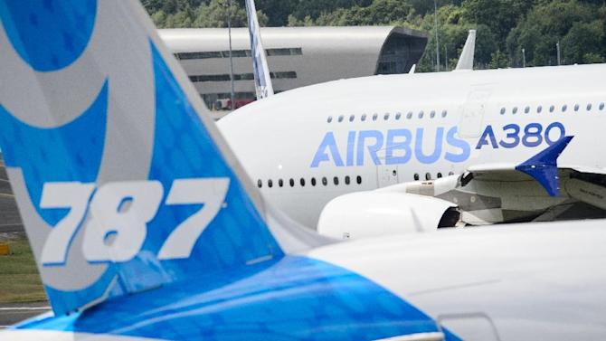 An Airbus A380 taxis past a Boeing 787 Dreamliner at the Farnborough air show on July 15, 2014