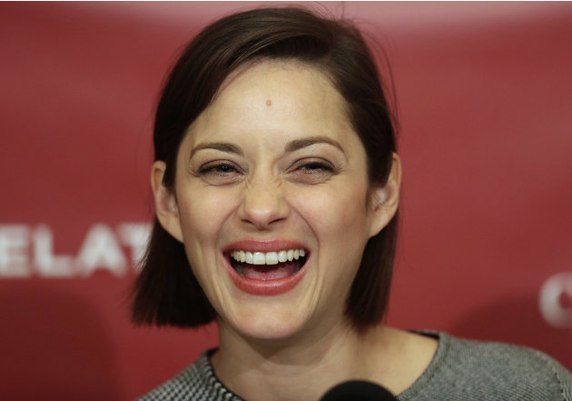 Hasty Pudding Woman of the Year, actress Marion Cotillard, of France, laughs during a news conference at Harvard University, in Cambridge, Mass., Thursday, Jan. 31, 2013. The award was presented to Co