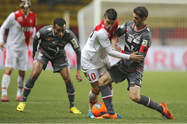 Monaco's James Rodriguez of Colombia, center, challenges for the ball with Ajaccio's Jean Baptiste Pierazzi of France during their French League One soccer match, in Monaco stadium, Sunday, De