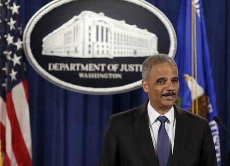 United States Attorney General Eric Holder holds a news conference announcing updates on investigation of Brown shooting in Ferguson Missouri, in Washington