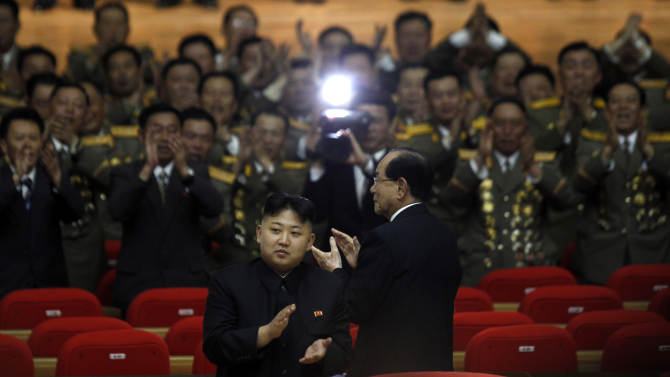 FILE - In this Wednesday, April 25, 2012 file photo, North Korea's leader Kim Jong Un applauds as he walks ahead of Kim Yong Nam, president of the Presidium of the Supreme People's Assembly after attending a concert to mark the 80th anniversary of the founding of the North Korean army in Pyongyang, North Korea. Kim is sending clear signals seven months into his rule that he intends to be a much different leader than his secretive father, Kim Jong Il. (AP Photo/Ng Han Guan, File)