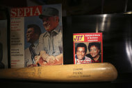 Items from the life of country music legend Charley Pride are shown in his recording studio in Dallas, Texas, Monday, Sept. 24, 2012. The Smithsonian has selected Pride to be part of the new National Museum of African American History and Culture opening in 2015 with Pride giving the museum items from his life. (AP Photo/LM Otero)